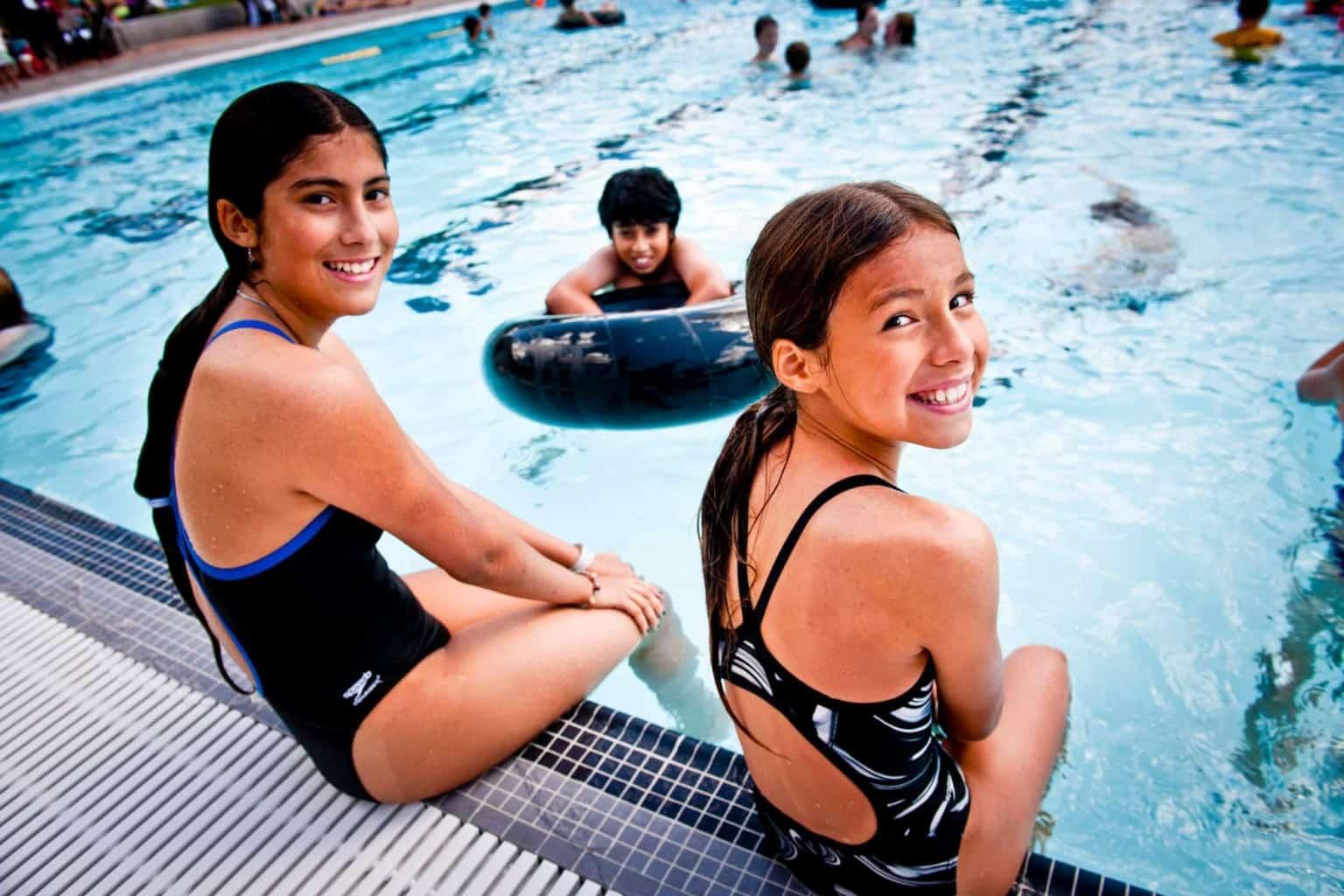 Girls smiling at swimming pool