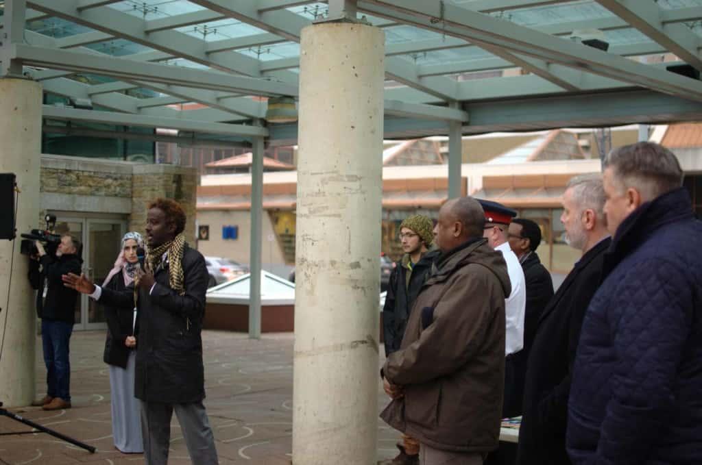 Edmonton-Delcore MLA Chris Nielsen and city Counc. Dave Loken hear Abdulkadir's message of unity at a rally.| Adam Millie