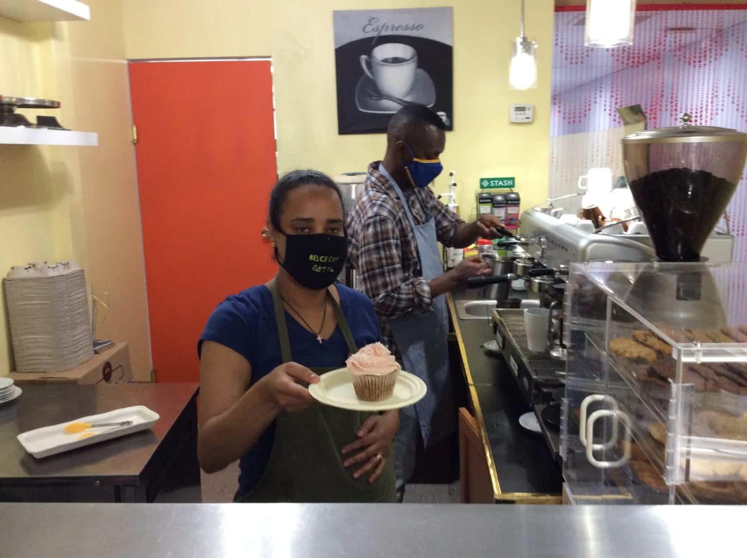 Belge Yimenu (front) and Abiy Andeyhun (back) serve a vegan cupcake specialty at Belge Café. | Constance Brissenden